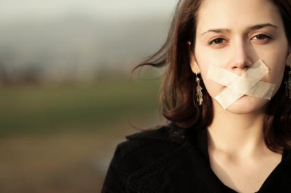 Woman, silenced.