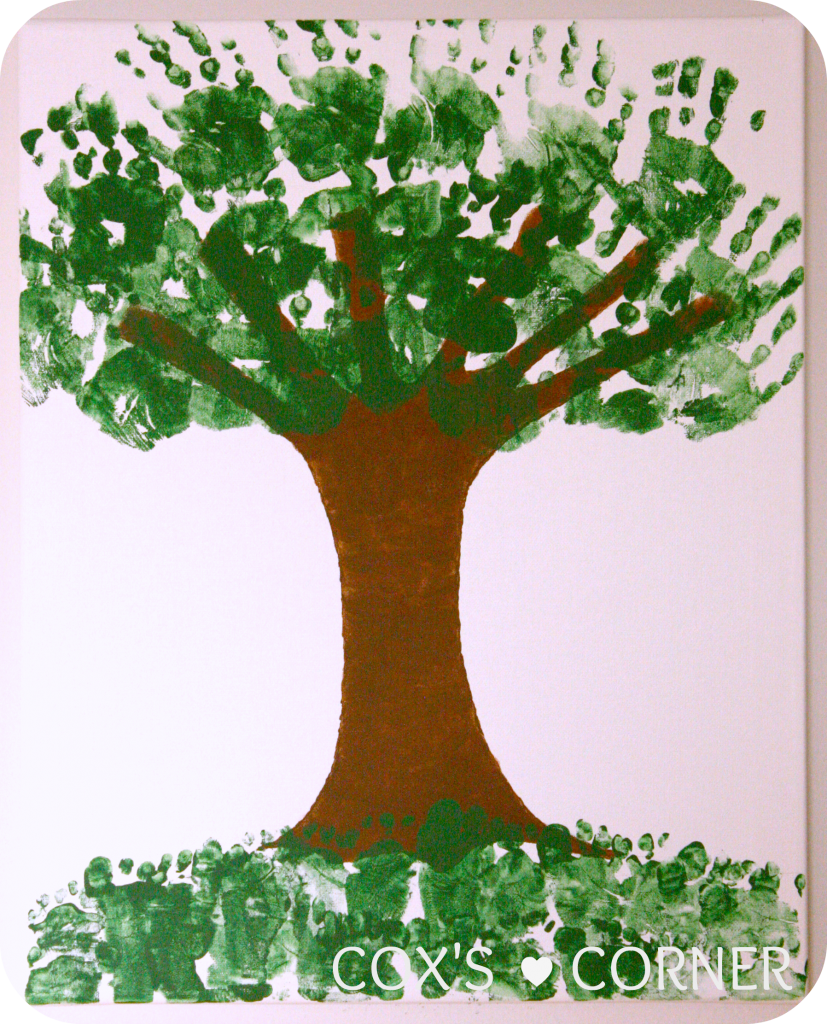Painted tree with green hand prints and feet prints