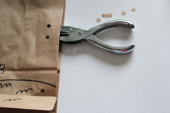Punch holes into one layer of bag to attach a fun straw!
